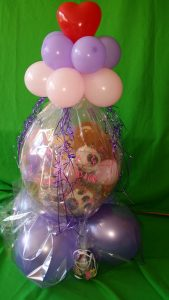 Geschenkballon mit einem Teddy